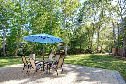 Osterville Osterville vacation rental - Relaxing back yard with grill, stone patio and hammock