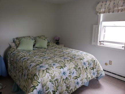West Dennis Cape Cod vacation rental - Queen bed in first floor bedroom, with window A/C unit.