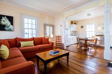 Provincetown Cape Cod vacation rental - Living room with large sectional opens into kitchen/dining
