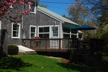 Brewster Cape Cod vacation rental - Back yard entertainment, deck, and outdoor shower