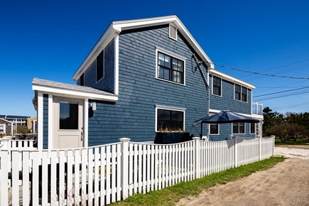 Provincetown Cape Cod vacation rental - Gated patio with outdoor dining and gas grill. Parking for 2 cars