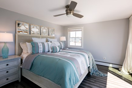 Provincetown Cape Cod vacation rental - Master bedroom with king bed, ceiling fan, AC and private deck