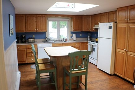 West Dennis Cape Cod vacation rental - Breakfast bar in the open kitchen with 8 person large oak table