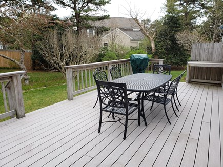 West Yarmouth Cape Cod vacation rental - Large deck with dining table, grill and lounge chairs