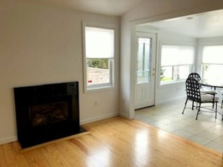 South Yarmouth Cape Cod vacation rental - Fire placed Kitchen leading into Sunroom