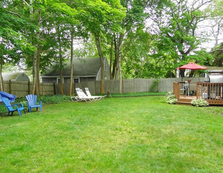 Colonial Acres, West Yarmouth Cape Cod vacation rental - Large back yard with seating and shed with bikes and beach suppli