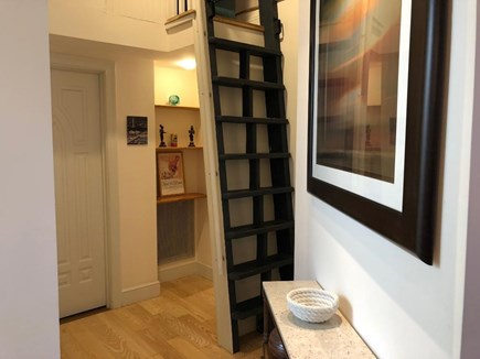 Provincetown Cape Cod vacation rental - Front hall ladder to access the loft