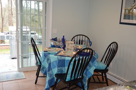 Brewster Cape Cod vacation rental - Eat-in-kitchen has a sliding door to the deck.  Table expands.