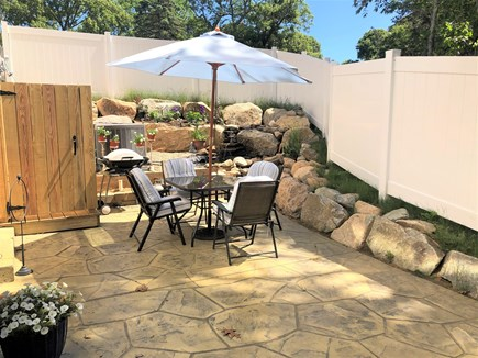 Eastham Cape Cod vacation rental - Private patio with grill, outside shower, and pond with waterfall