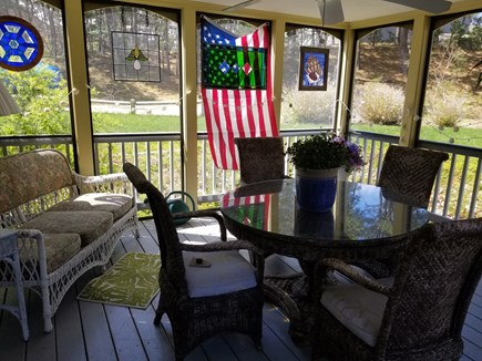 Wellfleet Cape Cod vacation rental - Screened in porch for dining-reading.