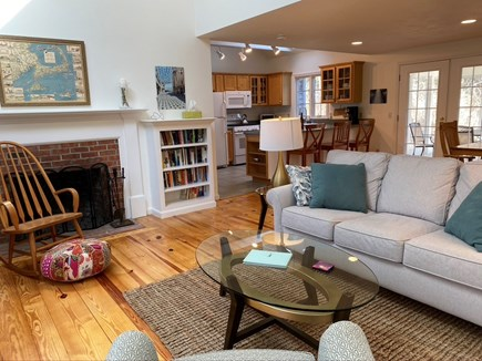 Eastham Cape Cod vacation rental - Living room with view to kitchen and porch