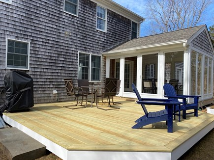 North Eastham Cape Cod vacation rental - New deck with outdoor seating, gas grill, next to screened porch.