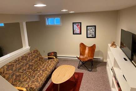 North Eastham Cape Cod vacation rental - Finished basement area. Foosball table in an alcove.