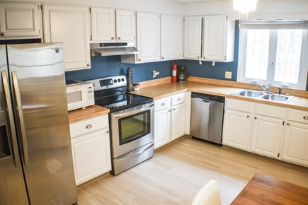 Eastham Cape Cod vacation rental - Full kitchen with Refrigerator, coffeemaker, stove, & dishwasher