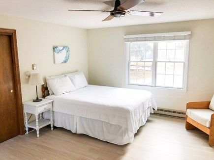 Eastham Cape Cod vacation rental - Master bedroom with private deck, TV, dresser, A/C, & full closet
