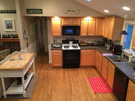Plymouth, Manomet MA vacation rental - Large kitchen with microwave, gas stove, dishwasher, and fridge.