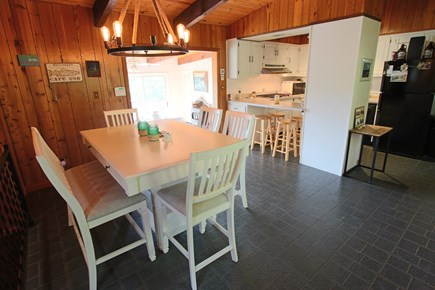 Wellfleet Cape Cod vacation rental - Dining area and kitchen, step down to the living room and master