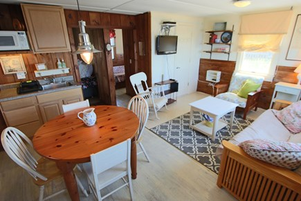 North Truro Cape Cod vacation rental - Living room with dining table and kitchen