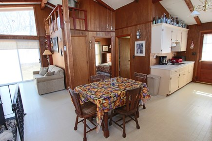 Truro Cape Cod vacation rental - Dining area and kitchen, bathroom and 2 bedrooms on same level