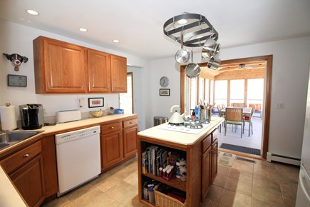 Wellfleet Cape Cod vacation rental - Well-equipped kitchen opens to lovely screened porch