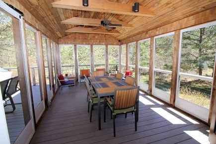 Wellfleet Cape Cod vacation rental - Lovely screen porch off kitchen with dining & lounging furniture