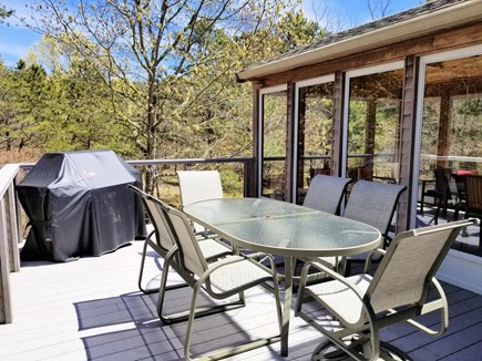Wellfleet Cape Cod vacation rental - Deck with outdoor furniture & gas grill overlooks wooded backyard