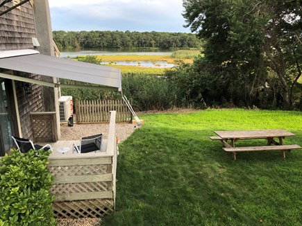 West Yarmouth Cape Cod vacation rental - Side deck with retractable awning & 8'picnic table