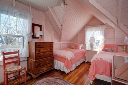North Falmouth, Megansett Cape Cod vacation rental - The Peach Room with two twin beds and a wash sink and mirror.