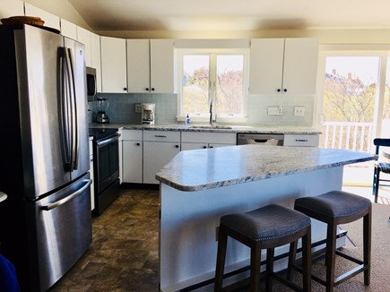 Dennis Cape Cod vacation rental - Kitchen view from different angle with bar stools