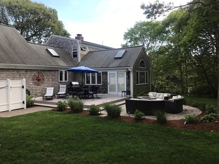 Dennis Cape Cod vacation rental - Back of house w/fire pit, seating area and large walk in shower