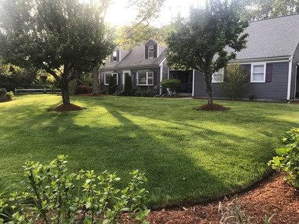 Dennis Cape Cod vacation rental - Beautifully landscaped front yard with covered front porch