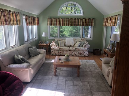 Dennis Cape Cod vacation rental - 2nd view of sun filled family room w/lots of seating, ceiling fan