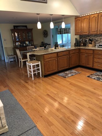Dennis Cape Cod vacation rental - Spacious kitchen w/granite counters, dining area seats 6 & bar 5