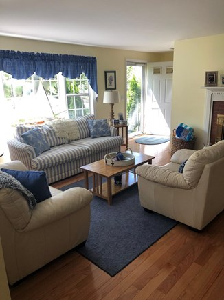 Dennis Cape Cod vacation rental - Sun filled living room with bay window and fireplace