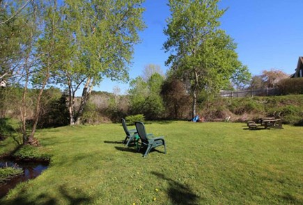 Wellfleet Cape Cod vacation rental - Large secluded back yard to watch sunsets over marsh.