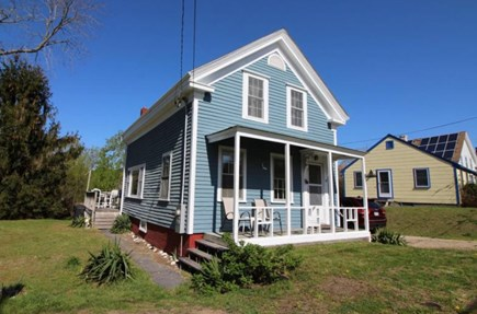 Wellfleet Cape Cod vacation rental - Side yard is secluded with arborvitaes.