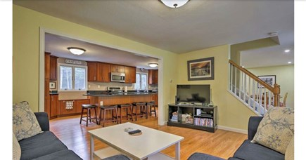 Falmouth, Waquoit Cape Cod vacation rental - Living room with open plan into kitchen and dining room
