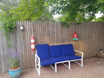 Dennis Port Cape Cod vacation rental - Sitting area private outside patio, Weber grill and flower pots