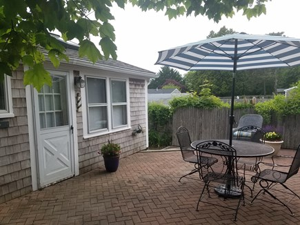 Dennis Port Cape Cod vacation rental - Private outside patio dining area with lounge area in back