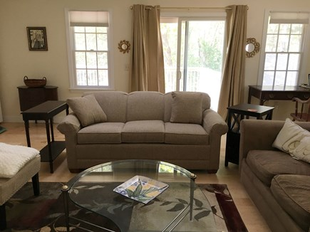Orleans Cape Cod vacation rental - Sun lit great room view B.  Opens onto rear deck.