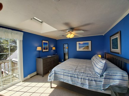 South Dennis Cape Cod vacation rental - Upstairs king with skylight, deck, and water views