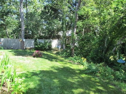 Chatham Cape Cod vacation rental - Lush back yard is filled with birds visiting the feeders