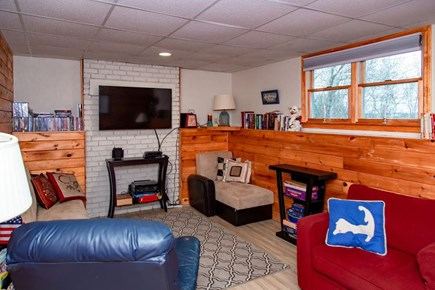 E Falmouth Cape Cod vacation rental - Lower Media Room with lots of games, movies and books!