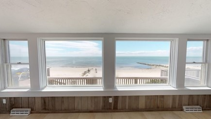 Harwich Cape Cod vacation rental - Living room over looking out side deck.