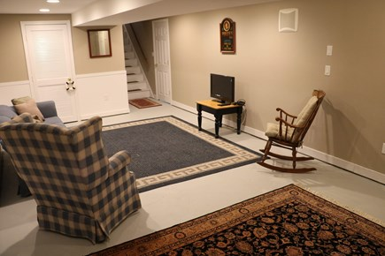 Dennis Port Cape Cod vacation rental - Finished basement with TV, couch, love seat and queen futon.
