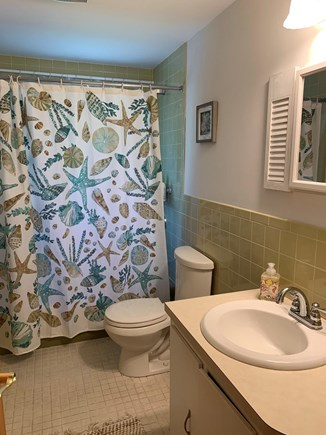 Dennis Port Cape Cod vacation rental - First floor bathroom with tub/shower.