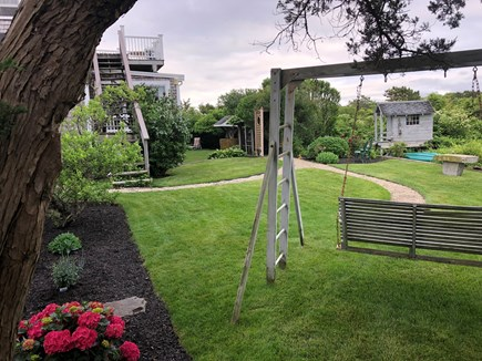 East Sandwich Beach Cape Cod vacation rental - Back yard with swings and view of playhouse.