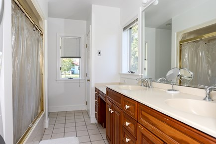 Eastham Cape Cod vacation rental - First floor master bath with washer /dryer