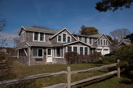 East Falmouth Cape Cod vacation rental - House & front yard (now has outdoor table & chairs)