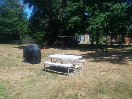 Dennis Cape Cod vacation rental - Big yard with picnic table and propane grill
